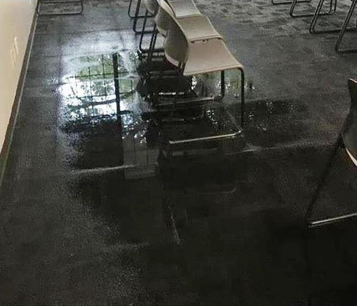 carpet covered in water in commercial property