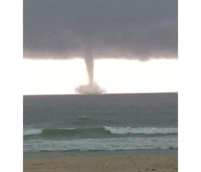 An Impressive Water Spout Ready to come ashore
