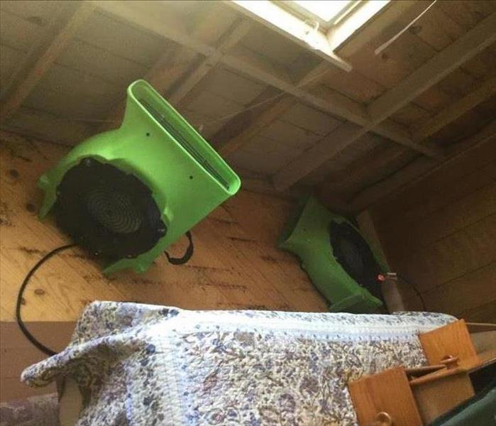 air movers set on a wooden floor drying out the enclosed porch