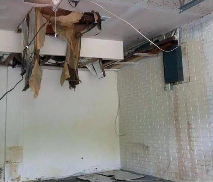 a ceiling caving in after flood damage struck